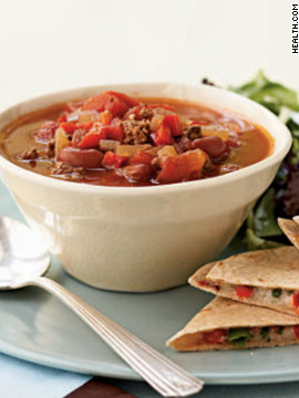 Cook a flavorful pot of chili in just 40 minutes for a quick, filling dinner that's only 261 calories per serving. The recipe easily doubles if you're expecting more guests. <strong>Try this recipe:</strong> <a href='http://www.myrecipes.com/recipe/beef-beer-chili-10000001654649/' target='_blank'>Beef and beer chili</a>