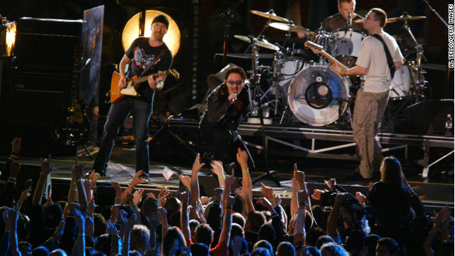 "At the first Super Bowl after 9/11, U2 performed a tribute to those lost in the attacks. As the band played ""MLK,"" the names of victims appeared on a screen. The show ended with a stirring version of ""Where the Streets Have No Name,"" and Bono revealing the American flag in the lining of his jacket."
