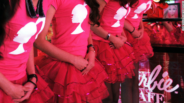Female wait staff wear tutus to complement the tiaras.