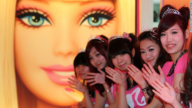 Tiaras and smiles at the opening of Taipei's Barbie Caf on Wednesday. This welcome by staff a subtle hint at what lies further ahead.