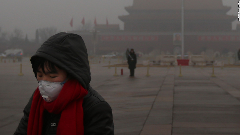 A pedestrian wears a mask at Tiananmen Square as protection from severe pollution on Thursday, January 31, 2013, in Beijing. It's the fourth time this year that a heavy blanket of smog has affected eastern China, including the capital. The air quality has reached hazardous levels, and residents were encouraged to avoid outdoor activities. &lt;a href='http://edition.cnn.com/video/#/video/world/2013/01/31/mr-beijing-smog.cnn' target='_blank'&gt;Watch a video explaining the hazardous smog.&lt;/a&gt;