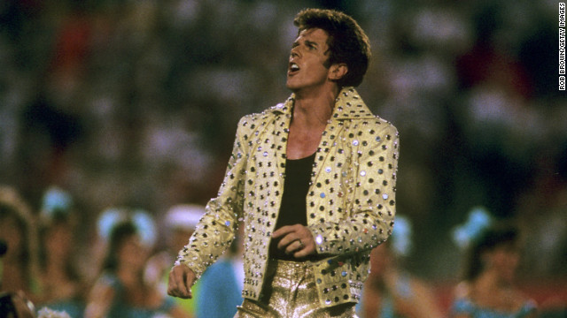 "In 1989, Elvis Presley impersonator Elvis Presto took to the Super Bowl stage in head-to-toe gold lamé to <a href='http://www.youtube.com/watch?v=b0Mz_TkBvLA&feature=player_embedded' target='_blank'>perform</a> ""the world's largest card trick"" among a bevy of Solid Gold dancers."