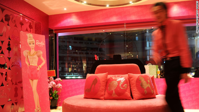 The entrance of Barbie Caf, featuring a purse-like sofa. More beauty salon than restaurant.