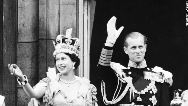 Queen Elizabeth II, with her husband Prince Philip, waves to the crowd on June 2, 1953, after being crowned at Westminter Abbey in London.