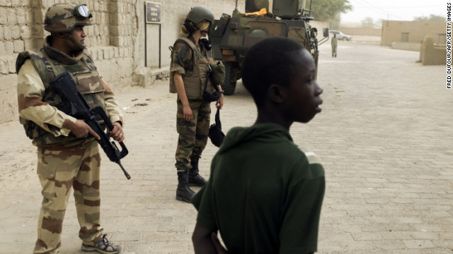 French soldiers patrol next to the Djingareyber mosque, on January 31,