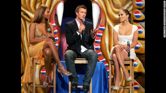 "Beckham poses with Beyonce, left, and Jennifer Lopez during a presentation of the new Pepsi ""Samourai"" in Madrid in 2004."