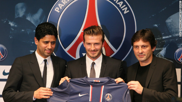 Beckham poses with Paris Saint-Germain President Nasser Al-Khelaifi, left, and PSG sports director Leonardo during a press conference announcing his new gig in January 2013.