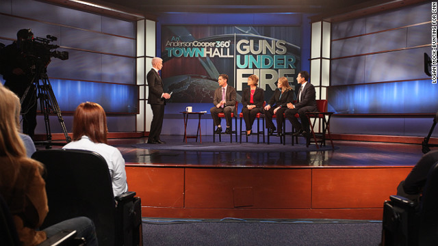 Anderson Cooper hosts panel members, from left, Dan Gross, president of the Brady Campaign; Sandy Froman, former NRA president; Cheryl Olson, who studies video games and violence; and Sanjay Gupta, chief medical correspondent for CNN, at the &quot;Guns Under Fire&quot; town hall event at George Washington University in Washington on Thursday, January 31.