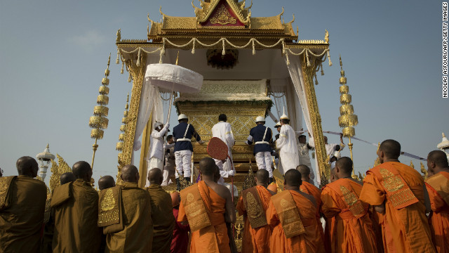The coffin of the late former King Norodom Sihanouk is lifted onto a chariot in front of the Royal Palace during his funeral procession on Friday.