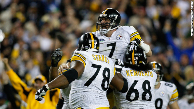 The Pittsburgh Steelers hold the record for most wins, taking the championship six times. Steelers quarterback Ben Roethlisberger celebrates with his teammates after throwing a fourth quarter touchdown against the Arizona Cardinals during Super Bowl XLIII.