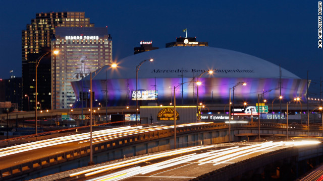 This Sunday will be the 10th time the Super Bowl has been hosted by New Orleans. A nighttime view shows the Mercedes-Benz Superdome.