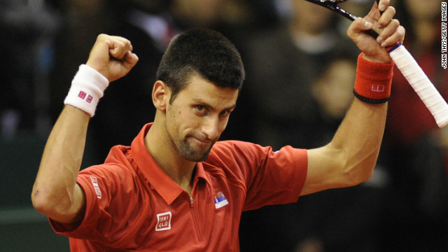 Novak Djokovic celebrates his straight sets victory over Olivier Rochus in the Davis Cup tie in Belgium.