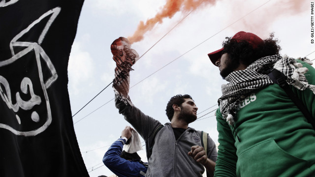 A protester holds a smoke flare outside the presidential palace on February 1.