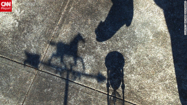 "iReporter Natalie Montanaro shot this photo of her shadow along with a horse weather vane and hourglass. ""I was thinking about the ""Wizard of Oz"" when I spotted the hourglass near the fireplace so I put on my dancing shoes to set up a shot,"" she said. ""I so wish that there will be an early spring."""