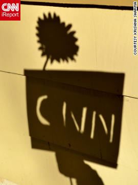 "iReporter Krishna Sharma took a fun spin on shadows on Groundhog Day. "" I used a few sheets of white paper and tried to cut out CNN via scissors,"" he said."