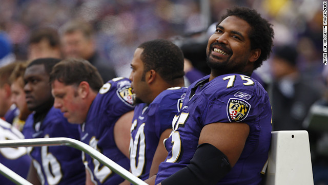Jonathan Ogden of the Baltimore Ravens smiles from the bench during a 2007 game against the Cleveland Browns in Baltimore. Ogden is among this year's Hall of Fame inductees.