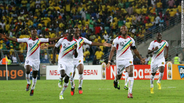 Mali players celebrate victory following a penalty shootout against South Africa in the African Cup of Nations quarterfinal.