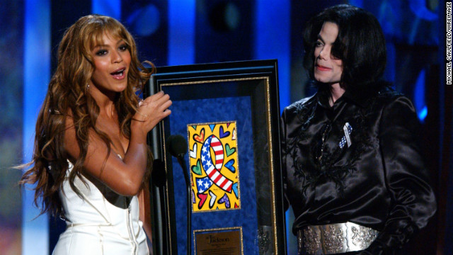 Having stepped out on her own, Beyoncé presents the humanitarian award to Michael Jackson at the 2003 Radio Music Awards in Las Vegas on October 27, 2003.