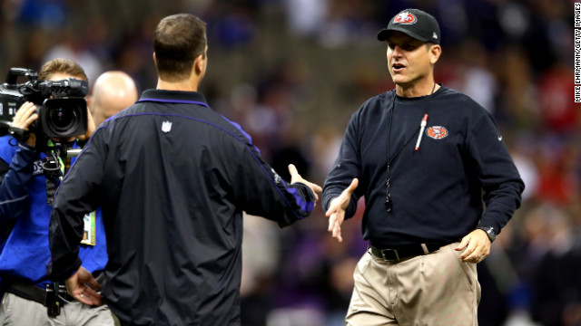 Head coach Jim Harbaugh, right, of the San Francisco 49ers shakes hands with his brother, head coach John Harbaugh of the Baltimore Ravens, prior to the start of Super Bowl XLVII.