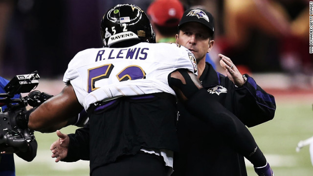 Head coach John Harbaugh of the Baltimore Ravens hugs linebacker Ray Lewis prior to the start of Super Bowl XLVII against the San Francisco 49ers.