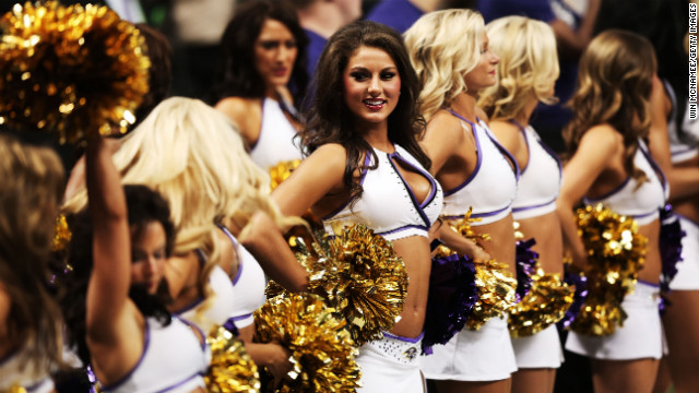 Ravens cheerleaders stand on the sidelines before Sunday night's game against the 49ers.