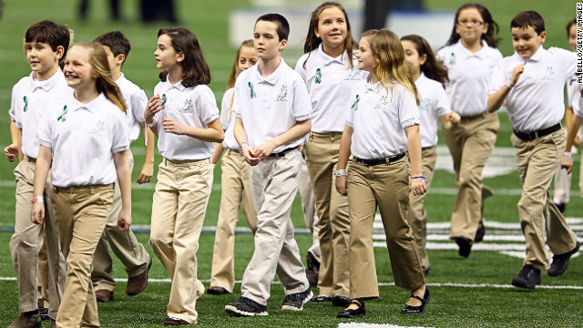 Children in the Sandy Hook Elementary School Chorus walk off the field after singing &quot;America The Beautiful&quot; prior to Super Bowl XLVII.
