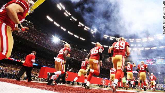 The San Francisco 49ers take the field.