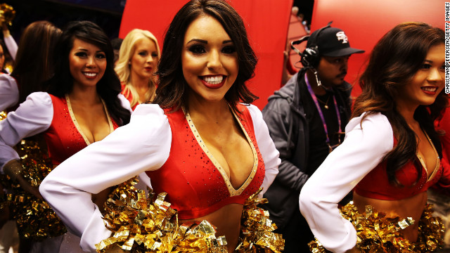 San Francisco 49ers cheerleaders get ready take the field ahead of the game against the Baltimore Ravens.