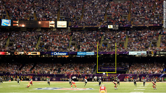 Justin Tucker of the Baltimore Ravens kicks the ball to the San Francisco 49ers to start Super Bowl XLVII.