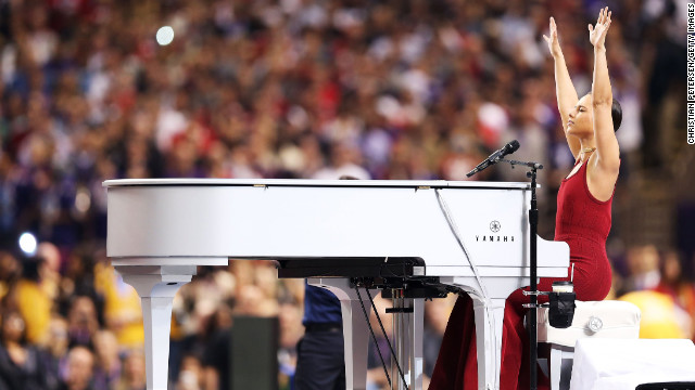 Alicia Keys reaches into the air during her rendition of the National Anthem.
