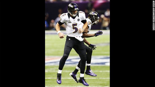 Joe Flacco, left, and Jacoby Jones of the Baltimore Ravens celebrate after Flacco threw a 1-yard touchdown pass to Dennis Pitta.