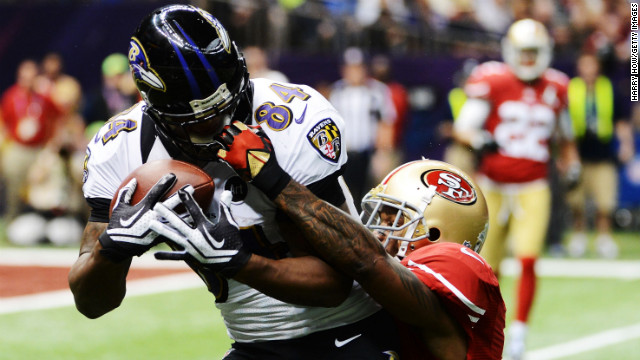 Donte Whitner of the San Francisco 49ers commits a face mask penalty against Ed Dickson of the Baltimore Ravens in the second quarter.