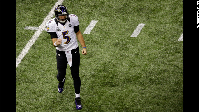 Ravens quarterback Joe Flacco celebrates after throwing a 1-yard touchdown pass to Dennis Pitta.