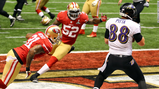 Dennis Pitta of the Baltimore Ravens catches a touchdown pass in front of Donte Whitner, left, and Patrick Willis of the San Francisco 49ers.