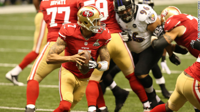 Quarterback Colin Kaepernick of the San Francisco 49ers rolls out of the pocket against the Ravens.