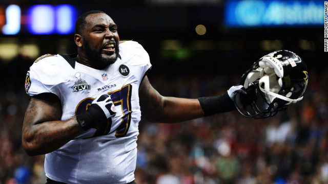 Arthur Jones of the Baltimore Ravens exults as he walks off of the field at halftime.