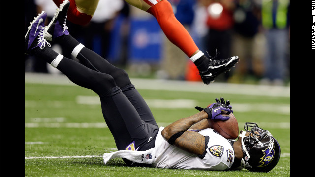 Jacoby Jones of the Ravens catches a 56-yard pass. He would get up and score.