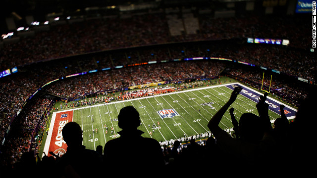 Fans cheer in the cavernouse Mercedes-Benz Superdome in New Orleans during Super Bowl XLVII.