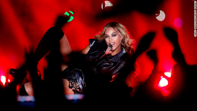 Beyonce lies on stage while performing Sunday night.