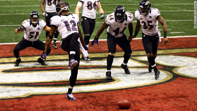 Jacoby Jones of the Baltimore Ravens, No. 12, does &quot;the Ray Lewis dance&quot; to celebrate his 108-yard kickoff return for a touchdown at the start of the third quarter.