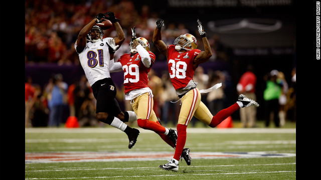 Anquan Boldin of the Baltimore Ravens attempts to catch a pass in front of Chris Culliver, center, and Dashon Goldson of the San Francisco 49ers.