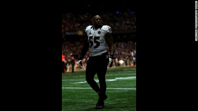 Terrell Suggs of the Baltimore Ravens paces on the field during the power outage.