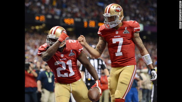 Frank Gore, left, and Colin Kaepernick of the 49ers celebrate after Gore scored a 6-yard rushing touchdown in the third quarter.
