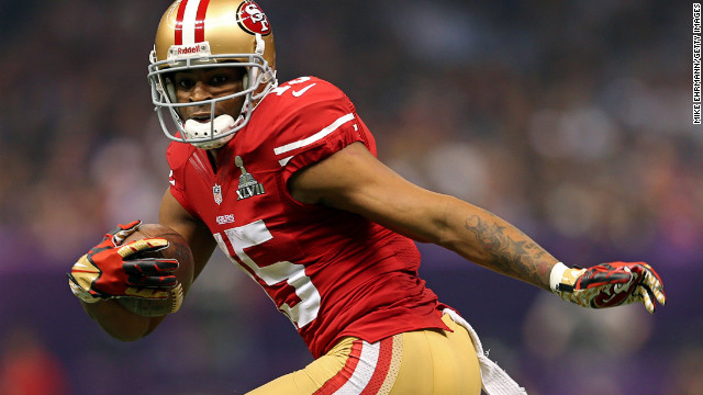 Michael Crabtree of the 49ers scores on a touchdown pass in the third quarter against the Baltimore Ravens.