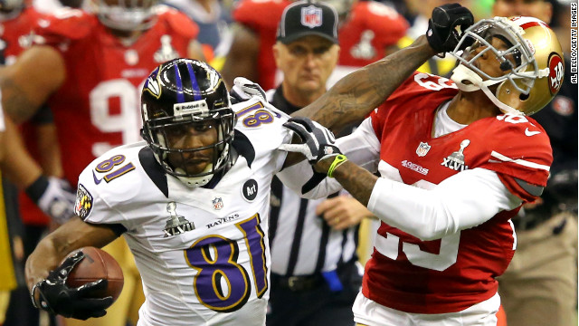 Anquan Boldin of the Baltimore Ravens stiff-arms Chris Culliver of the San Francisco 49ers a