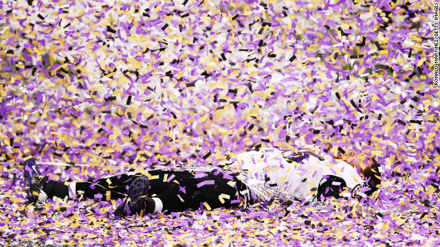 Morgan Cox of the Baltimore Ravens lies on the field while celebrating after defeating the San Francisco 49ers 34-31 in Super Bowl XLVII at the Mercedes-Benz Superdome on Sunday, February 3, in New Orleans, Louisiana.