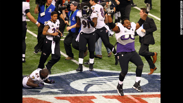 Bobbie Williams of the Baltimore Ravens, right, and his teammates celebrate their win against the San Francisco 49ers.
