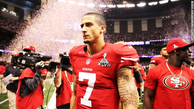 49ers quarterback Colin Kaepernick walks off the field after the game.