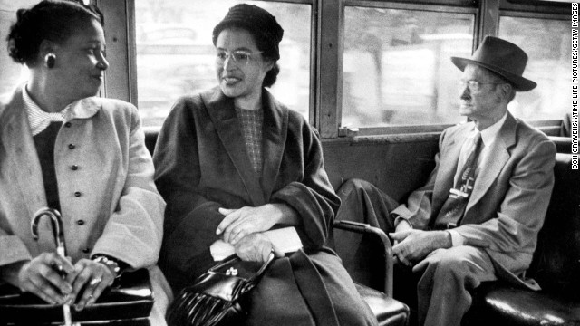 Parks rides on a newly integrated bus in 1956 following the court ruling desegregating Montgomery's public transportation. It wasn't until the 1964 Civil Rights Act that all public accommodations nationwide were desegregated.