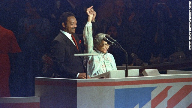 The Rev. Jesse Jackson shows solidarity with Parks at the Democratic National Convention in Atlanta in 1988. Jackson had been a candidate in the Democratic primaries that year.